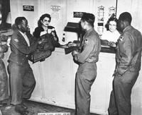 African American servicemen with USO office personnel, Salt Lake City, Utah, ca. 1942 - 1946