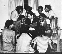 African American woman reading to children, Charlestown, Indiana, ca. 1942-1946